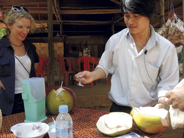 Mr.-Pros,-our-driver,-makes-a-special-treat-of-coconut-and-toasted-rice-called-nhorm-ambok-001.jpg