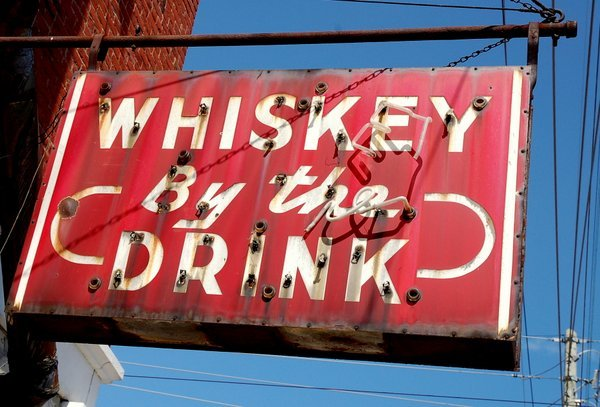 Whiskey by the drink sign at Shirley Mae's