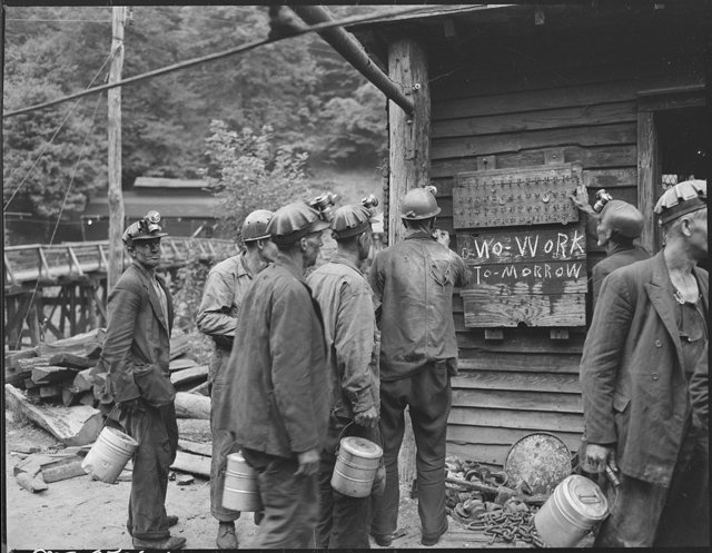 Miners_bring_in_their_checks_and_see_the_sign_that_there_is_no_Saturday_work._P_V_&_K_Coal_Company,_Clover_Gap_Mine..._-_NARA_-_541295.jpg
