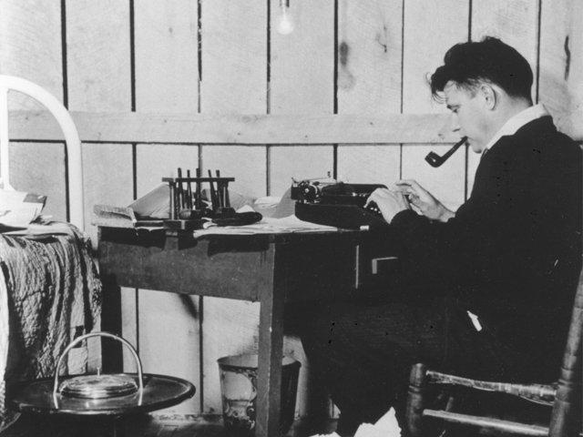 Jesse Stuart at desk
